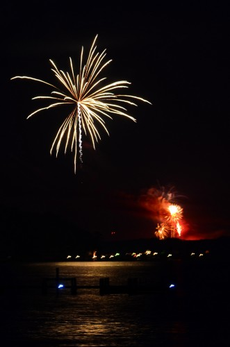 Fireworks as seen from Fishing Bay Yacht Club. On the left is a firework from Stove Point while in the background are fireworks from Matthews County.